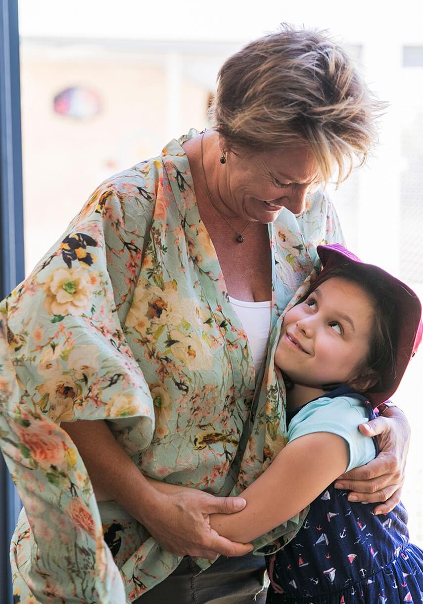 Rockingham Montessori School female student hugging her female teacher